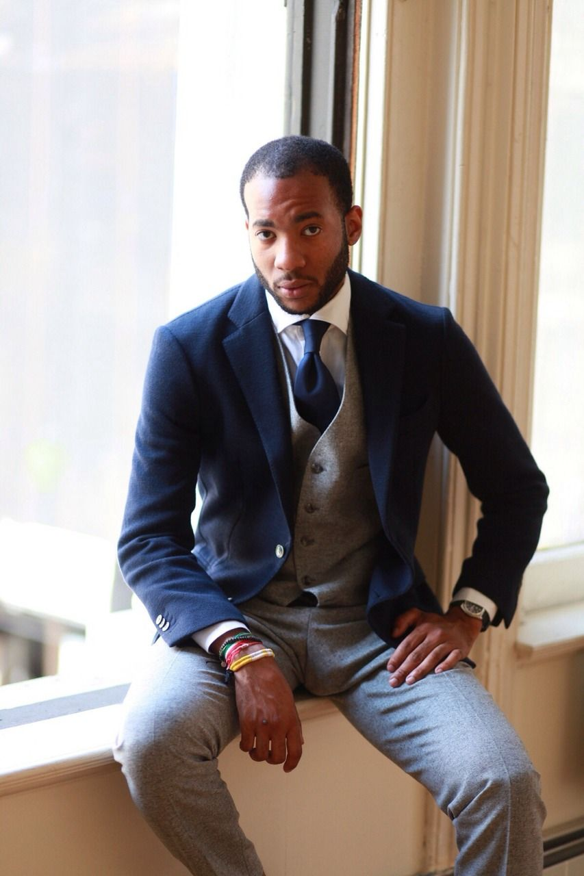 Grey pants with navy blazer and tie. Well dressed men