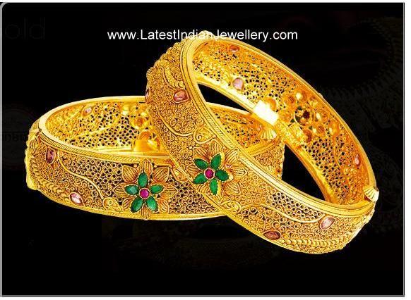 3bfd4964f34 Lovely Exotic Designer Gold Bangles Embossed with Floral Design ...