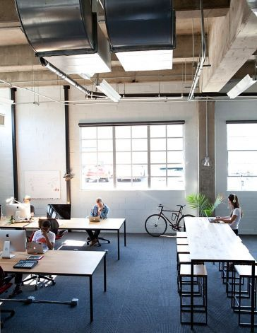 Startups 39 office space needs unique design bloomberg for Cool office layouts