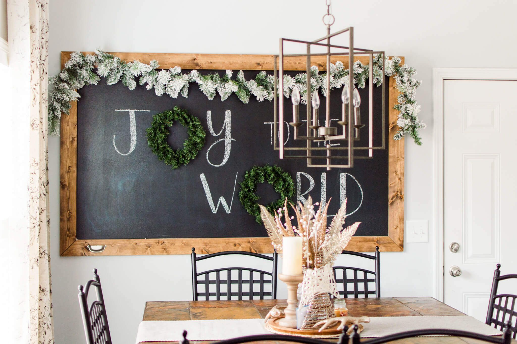 Christmas Chalkboard in the Breakfast Nook #christmaschalkboardartideas Christmas Chalkboard in the Breakfast Nook / ahostinghome.com // christmas chalkboard. christmas chalkboard art. christmas chalkboard signs. christmas chalkboard ideas. christmas chalkboard easy. christmas chalkboard christian. christmas chalkboard DIY. christmas chalkboard quotes. christmas chalkboard wall. christmas chalkboard simple. christmas chalkboard Jesus. christmas chalkboard farmhouse. christmas chalkboard kitchen. #christmaschalkboardartideas