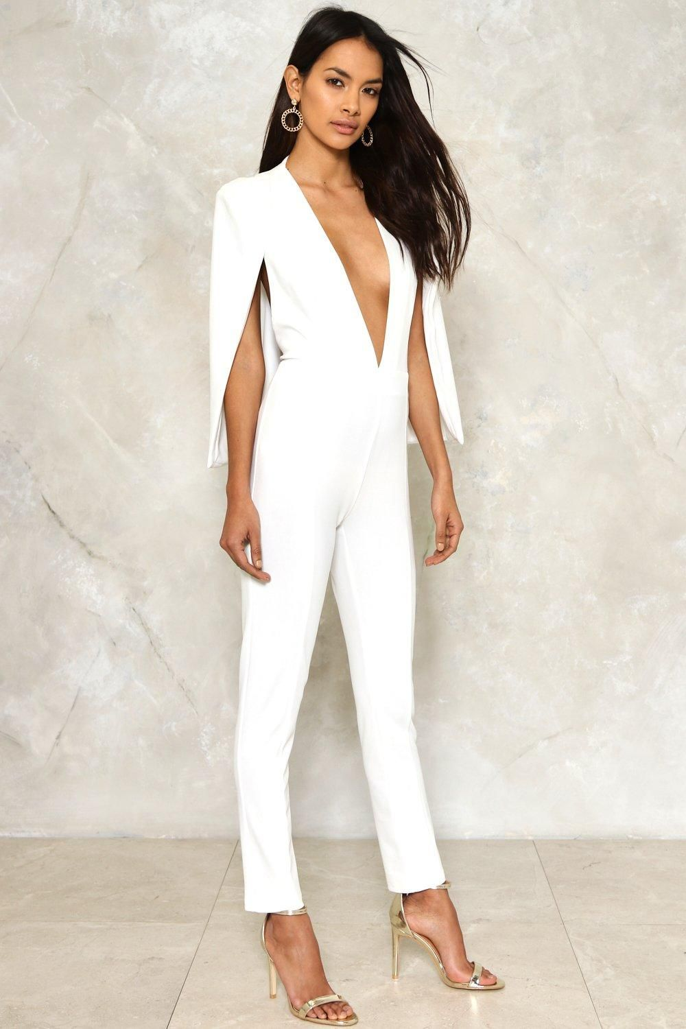 2e568ba2901e The Cape it Together Jumpsuit features a plunging neckline