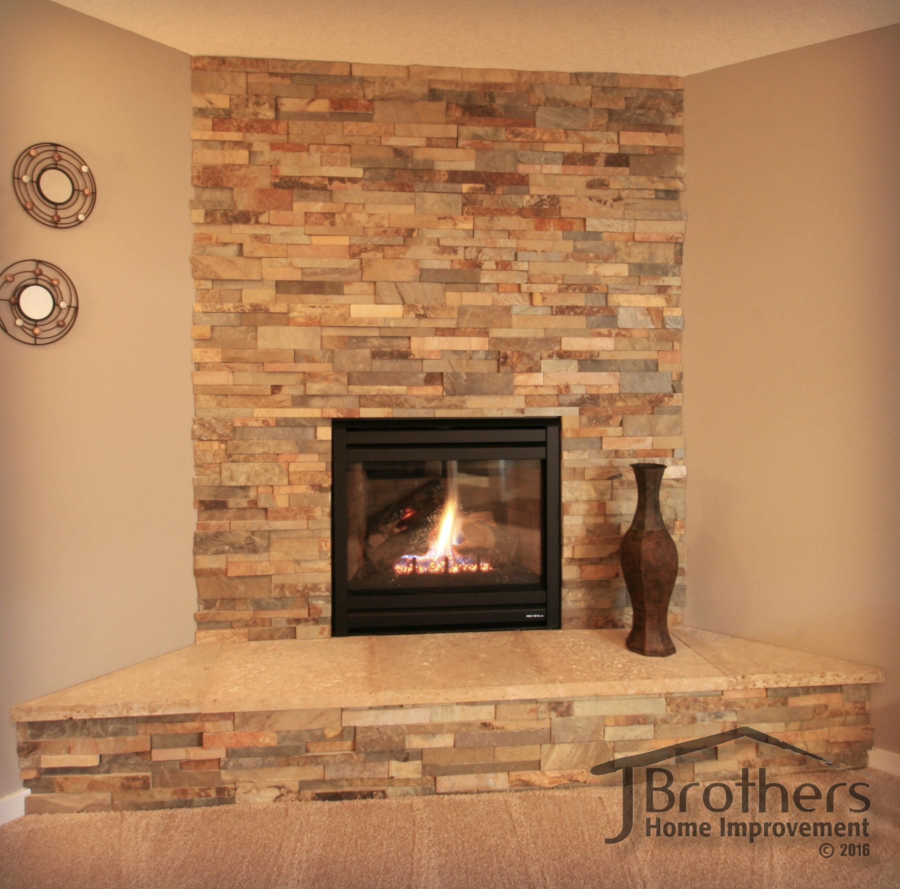 Fireplace by j brothers home improvement in maple grove