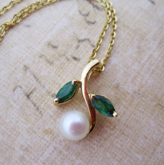 Etsy listing at https://www.etsy.com/listing/101328100/emerald-and-pearl-green-leaf-pendant-in