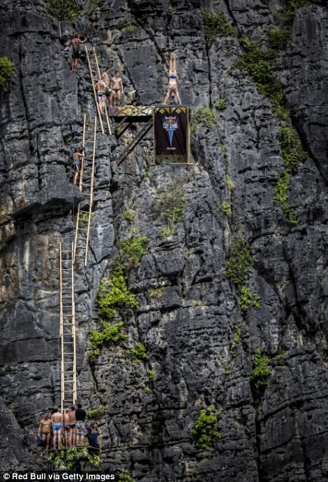 Magnificent images of death-defying cliff divers tumbling into Thailand's clear seas for world championship final. I don't know about those ladders...insane