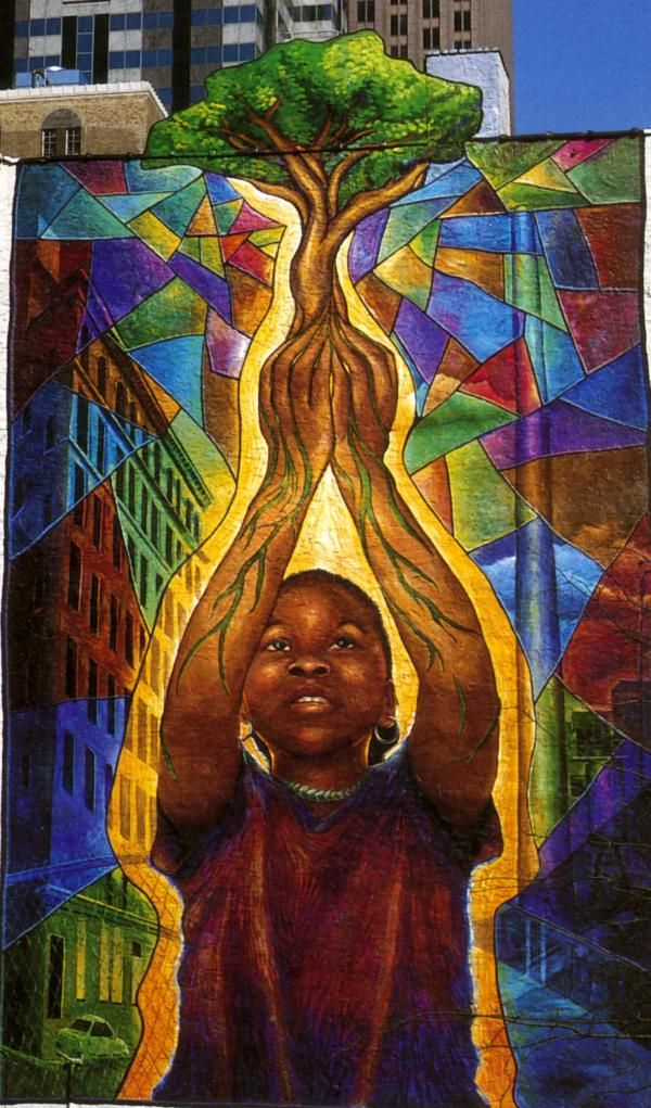 The mural features an african american girl reaching for for African american mural