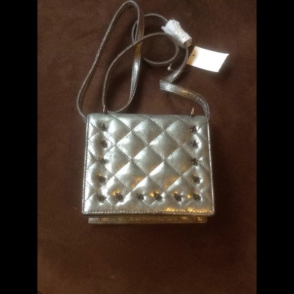 """BCBG crossbody bag Silver metallic  new purse with studs. 7"""" L, 6"""" H, 2"""" W and 21"""" long strip. BCBGeneration Bags Crossbody Bags"""