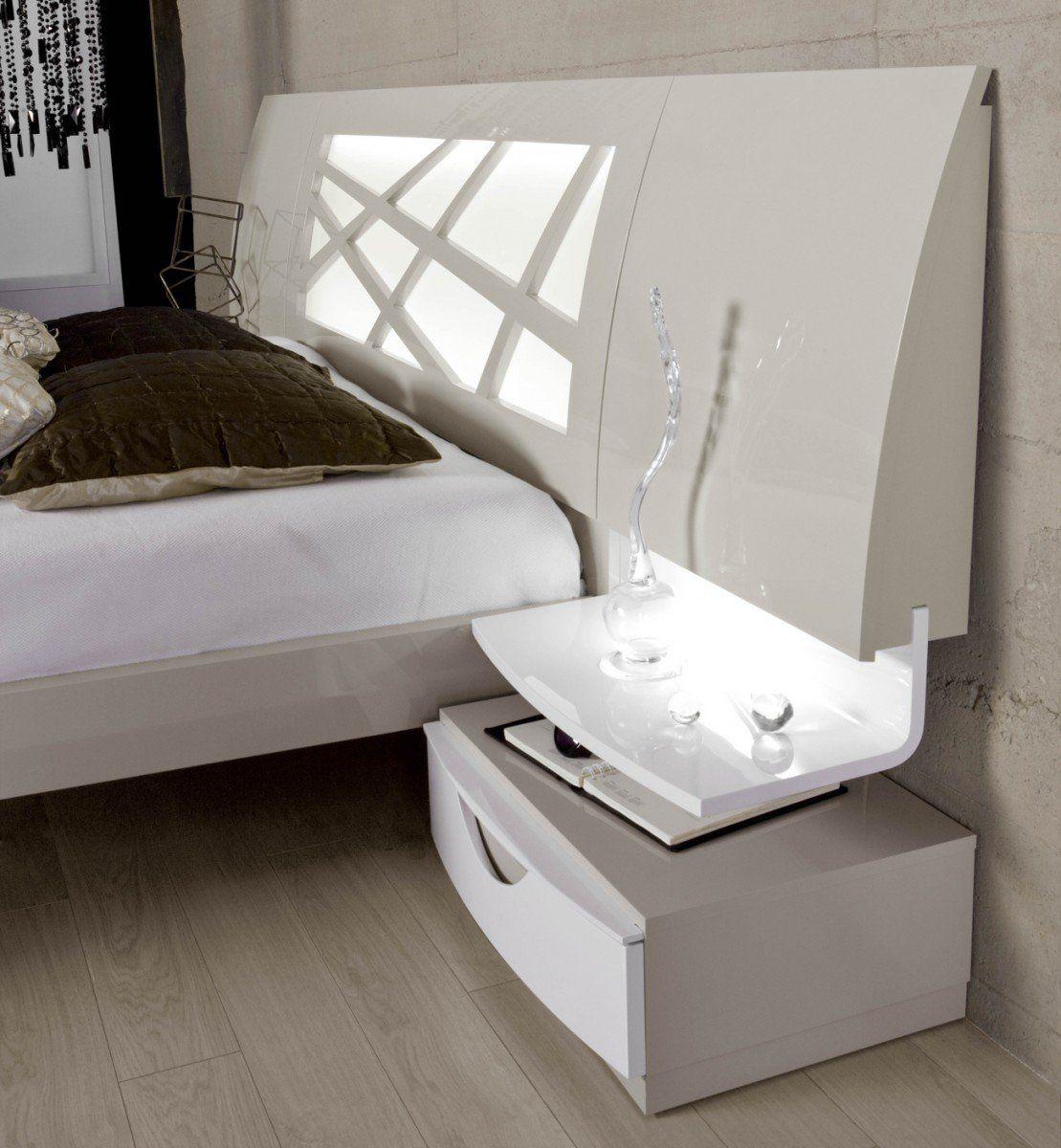 un dormitorio con un diseño exquisito con acabados lacados en