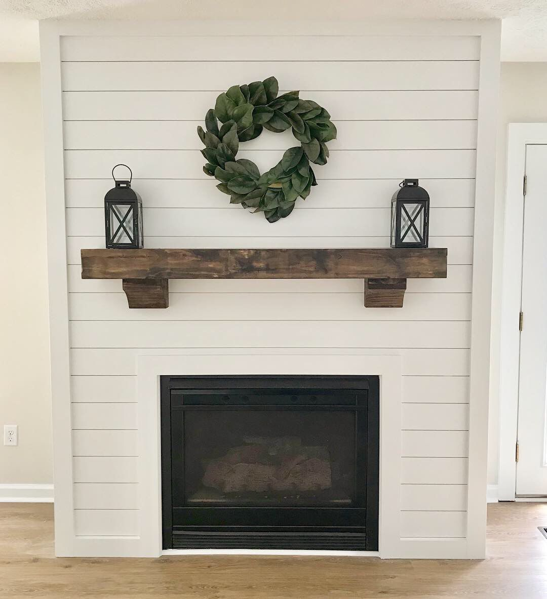 Shiplap Fireplace With Magnolia Wreath And Floating Wood Mantel