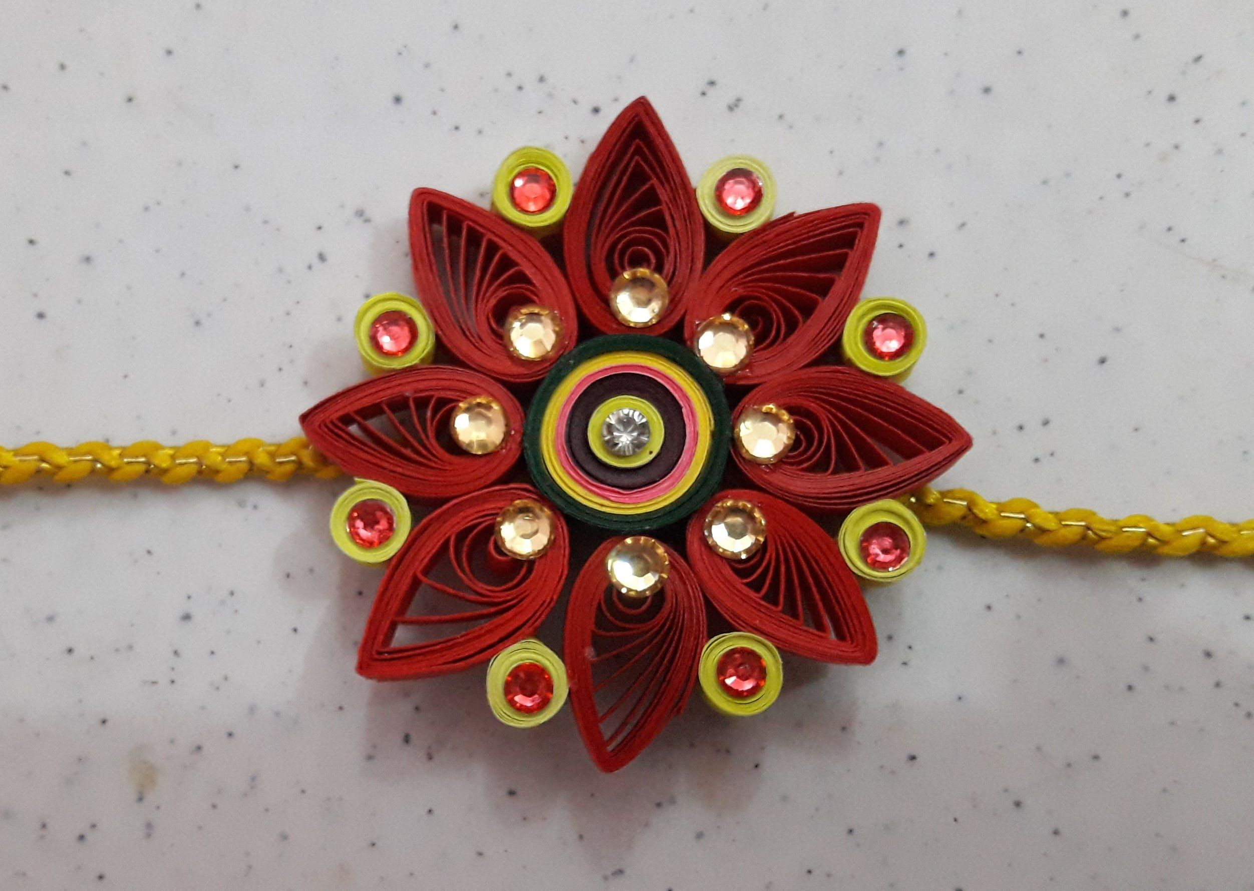 How to make quilling rakhi at home pinterest in this video we are making quilling lovely rakhi in this we are use toothpick fevicol colorful paper strip laces stones dhlflorist Gallery