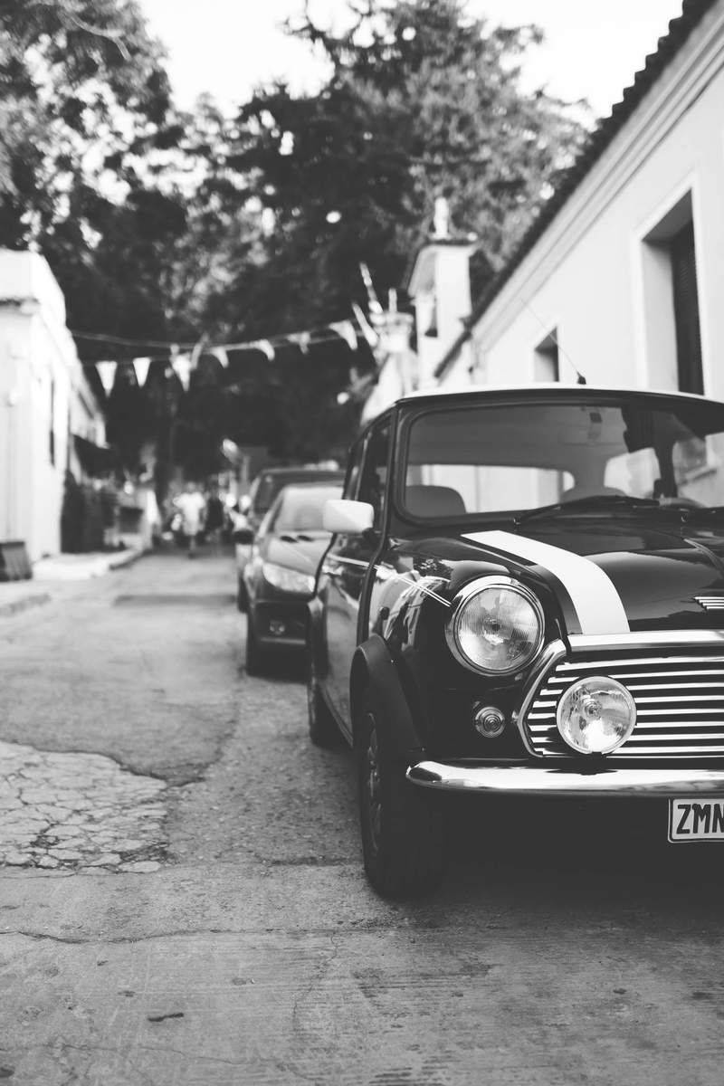 New free photo from Pexels: https://www.pexels.com/photo/grayscale-photography-of-a-black-and-white-car-in-a-road-near-3-person-sitting-near-a-green-tree-160057/ #black-and-white #cars #road