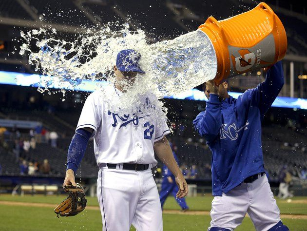 KANSAS CITY, MO - MAY 1: Elliot Johnson #23 of the Kansas City Royals is doused with water by George Kottaras after their 9-8 win over the Tampa Bay Rays at Kauffman Stadium on May 1, 2013 in Kansas C