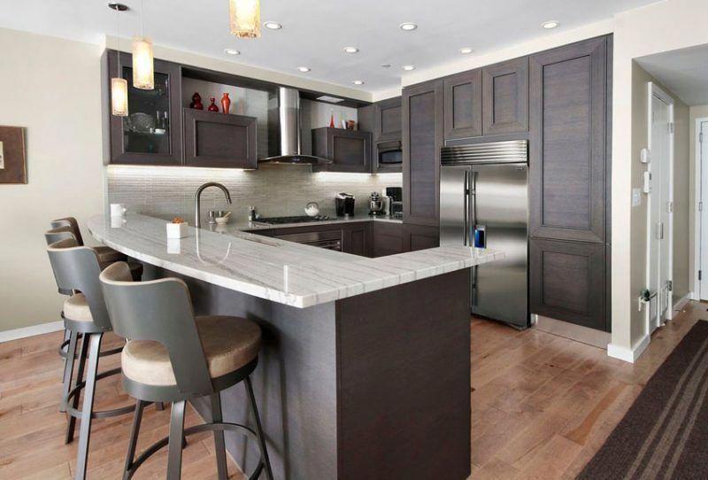 Contemporary Kitchen With Peninsula Dark Cabinets And Mini Pendant
