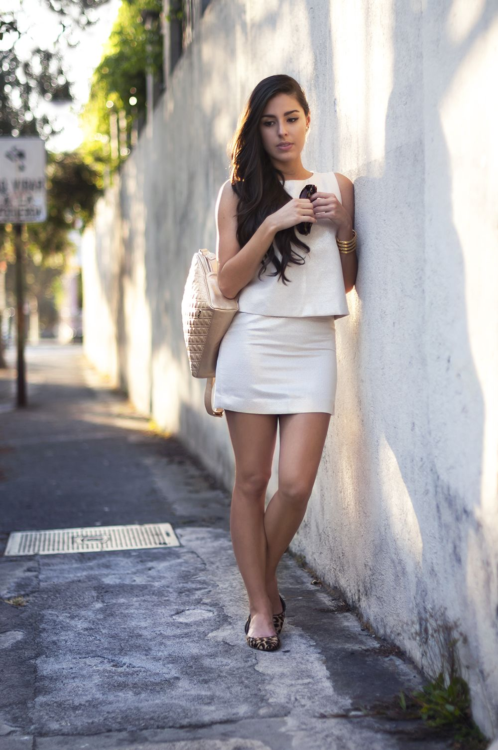 Blogger Lissa Barquero from The Peppermint win soft colors look and animal print flats strolling in San Jose downtown
