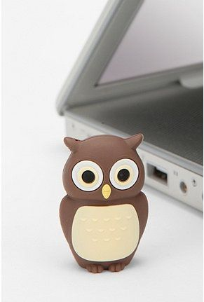 Tiny silicone-coated flash drive - adorably hidden underneath a little figure. The USB 2.0 drive can hold 4 gigabytes of data. Includes lanyard hole; LED indication for data access.