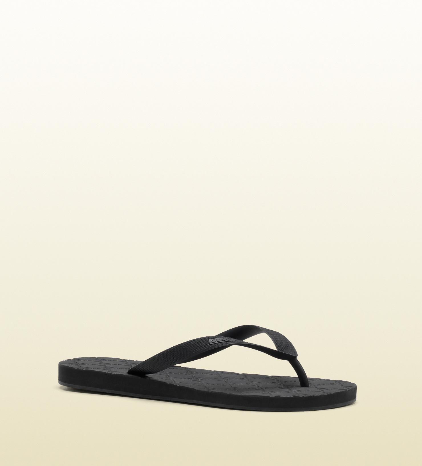 75377ebcb50 Gucci - 283029 J8700 1000 - gucci logo thong sandal - website exclusive black  rubber Made in Italy gucci embossed textured thong GG embossed top sole  ...