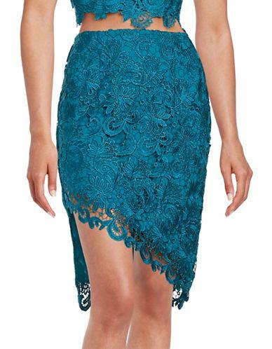 <ul> <li>An ultra-chic lace skirt with an asymmetrical…