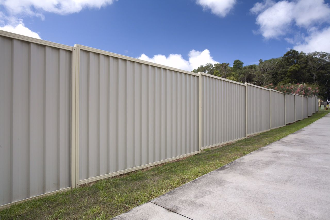 Colorbond sheets brisbane - Colorbond Fencing By The Roadside With Domain Posts And Rails And Surf Mist Sheets