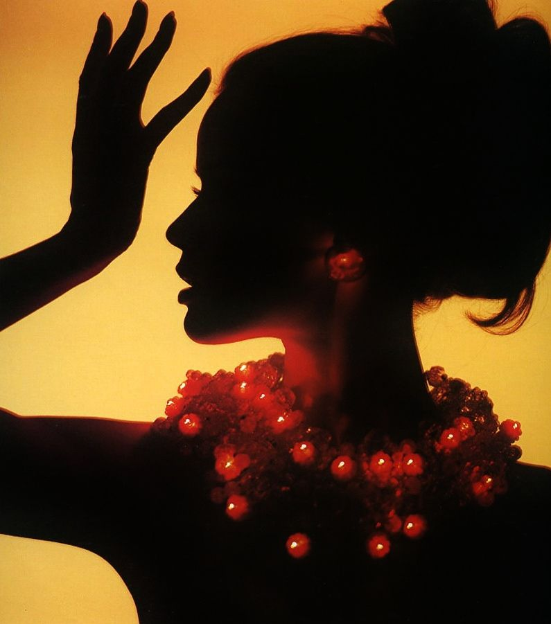 '60s model Veruschka photographed wearing a beautiful light-up necklace of flowers by Bert Stern in 1963.