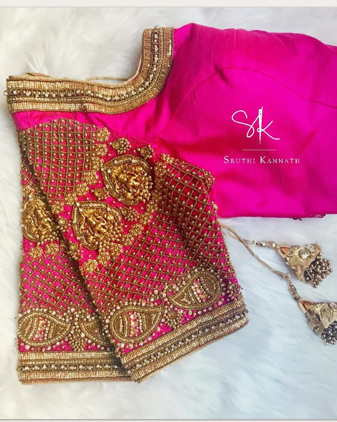 2f550f3cd8867 Stunning pink color bridal blouse with Lakshmi devi motifs on sleeves.  Blouse with hand embroidery zardosi and bead work. 02 October 2018