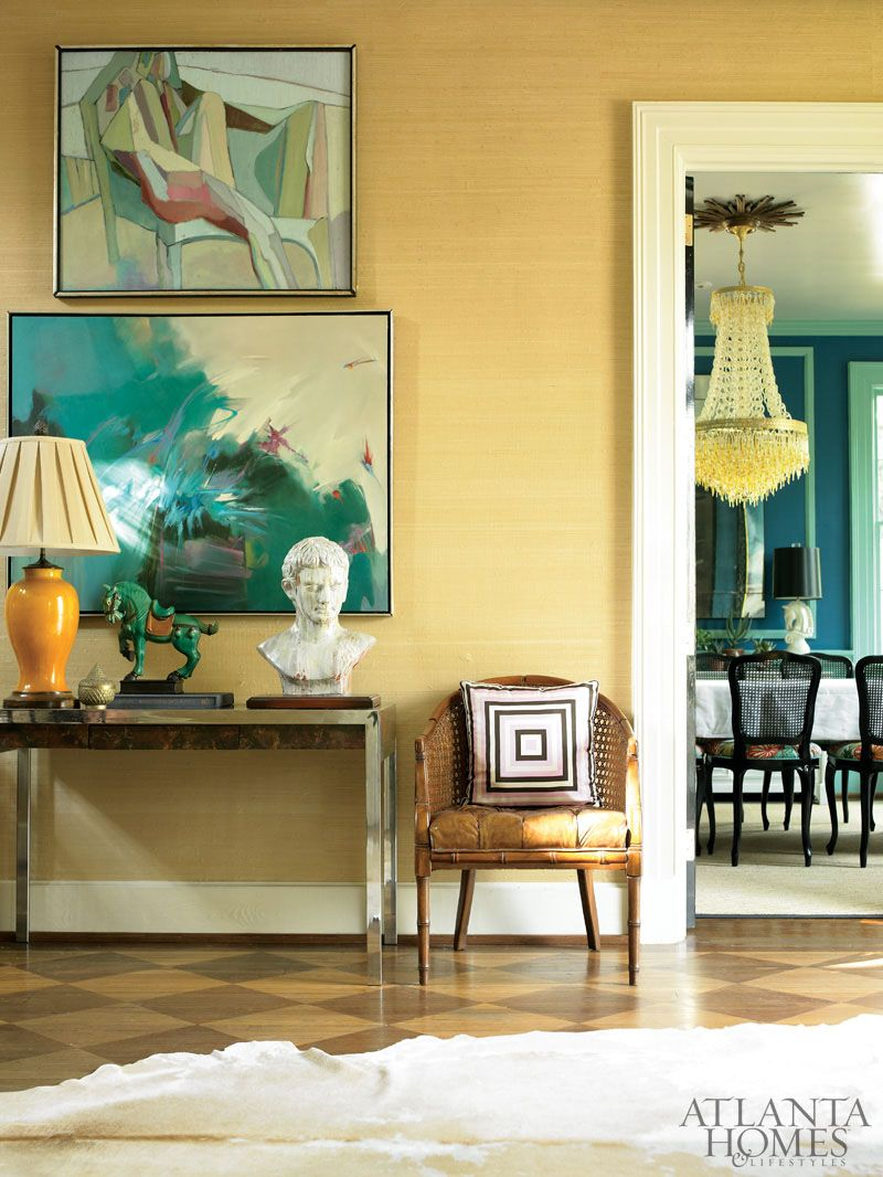 Against a backdrop of grasscloth wall covering, fine art and vintage ...
