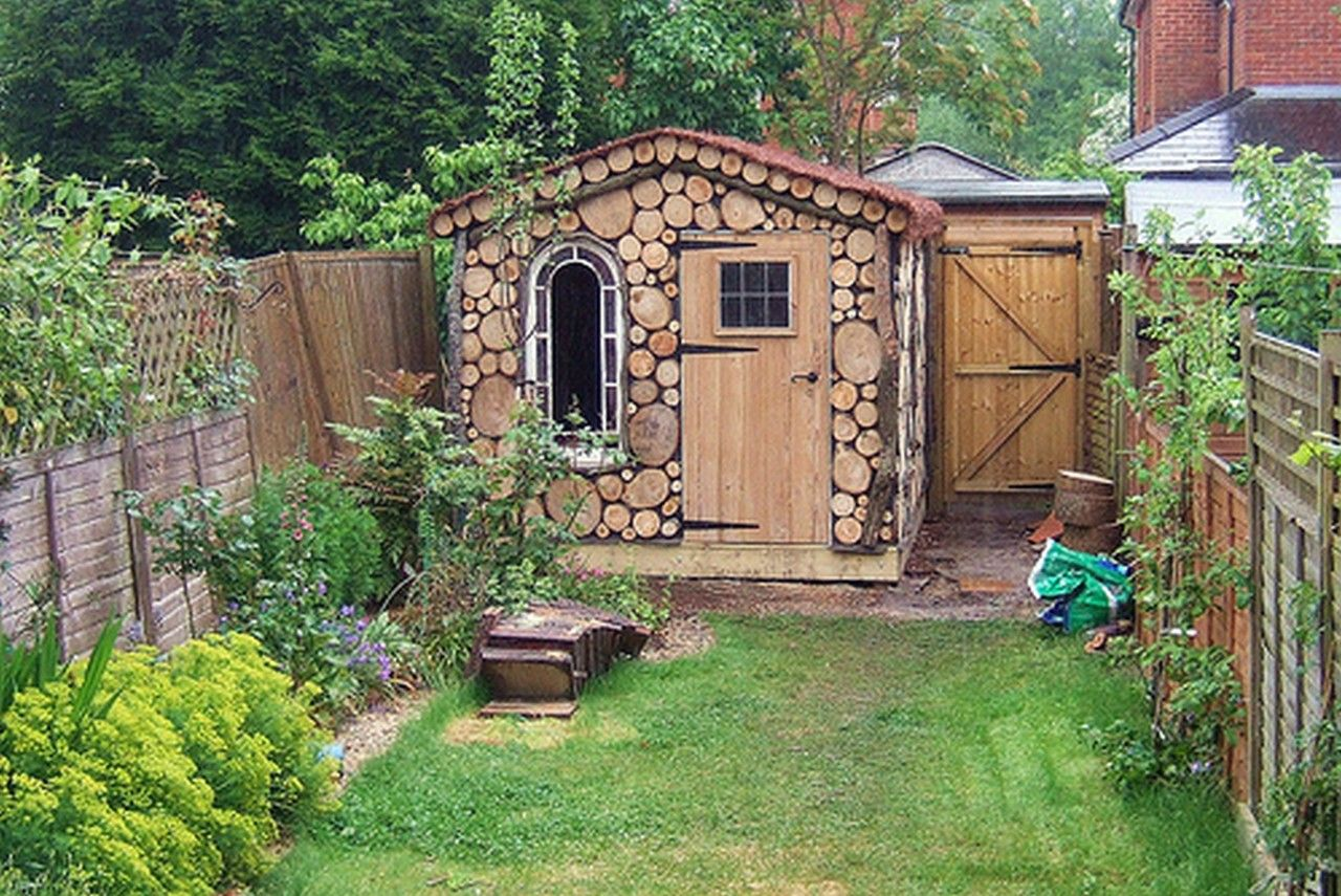 Exterior Pretty Garden Shed With Stone Artistic Wall And Unique Oval Window Exterior Lo Cheap Garden Sheds Garden Design Ideas On A Budget Backyard Landscaping