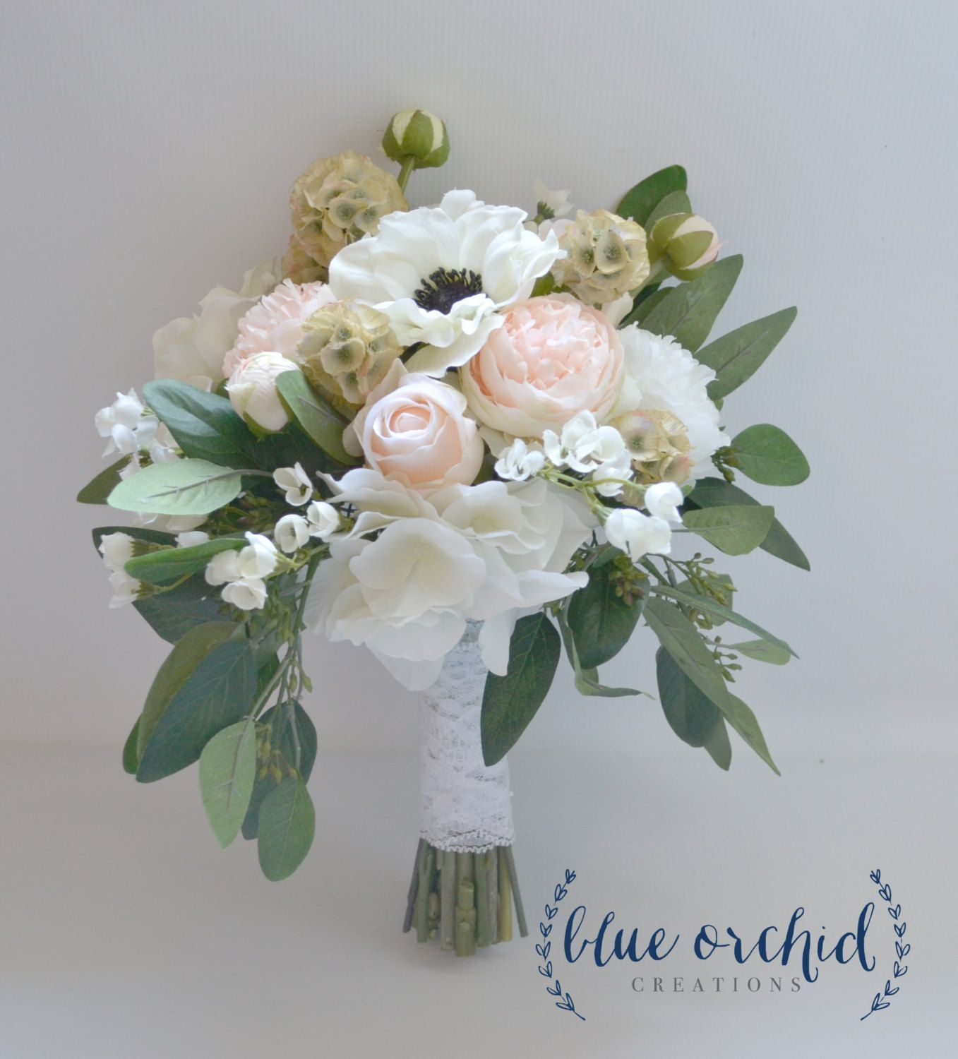 This wedding bouquet is one of our deluxe designs only the highest this wedding bouquet is one of our deluxe designs only the highest quality silk flowers have been included blush and cream colored peonies ranunculus izmirmasajfo Choice Image