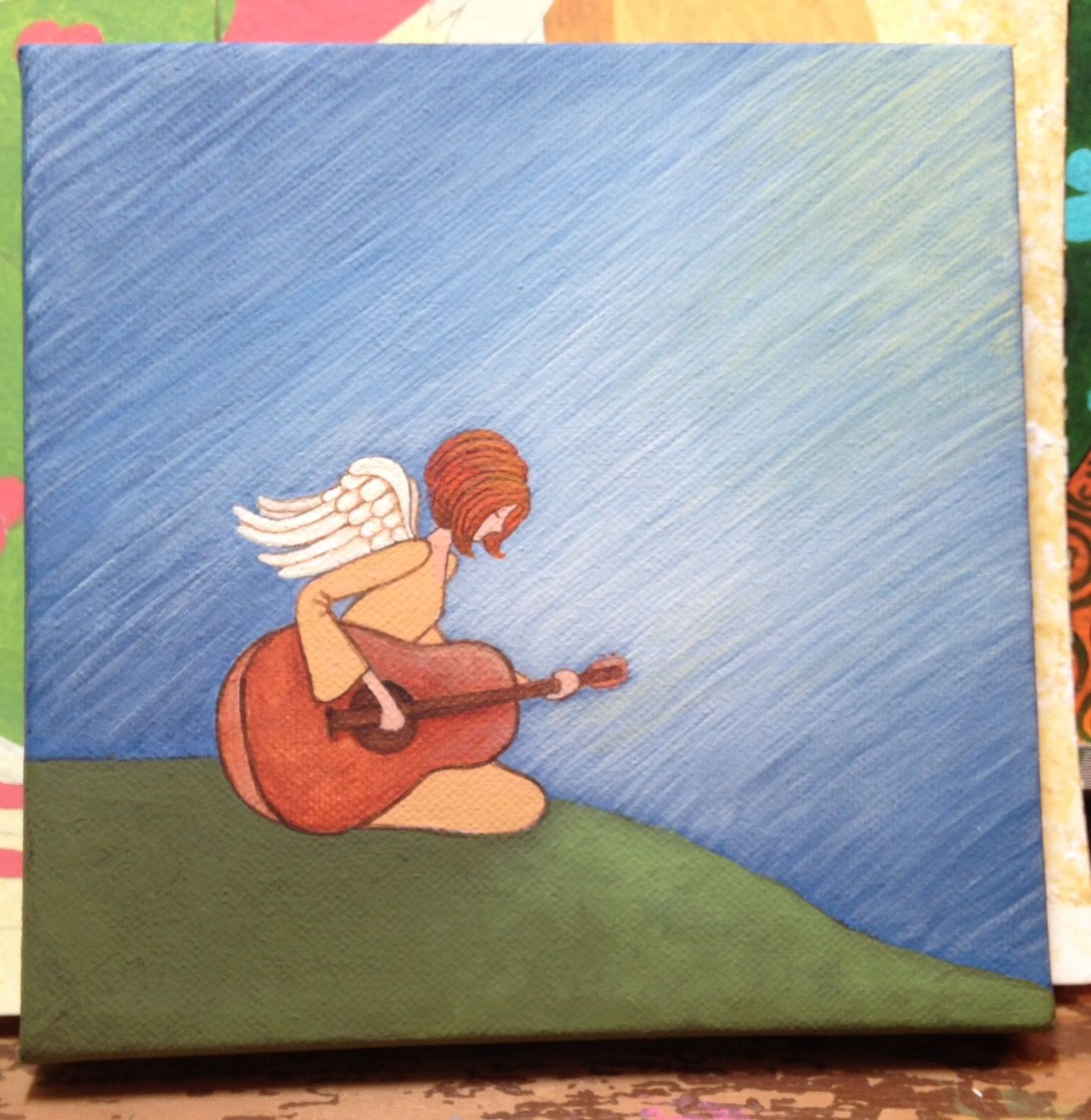 small acrylic on canvas...angel playing a guitar