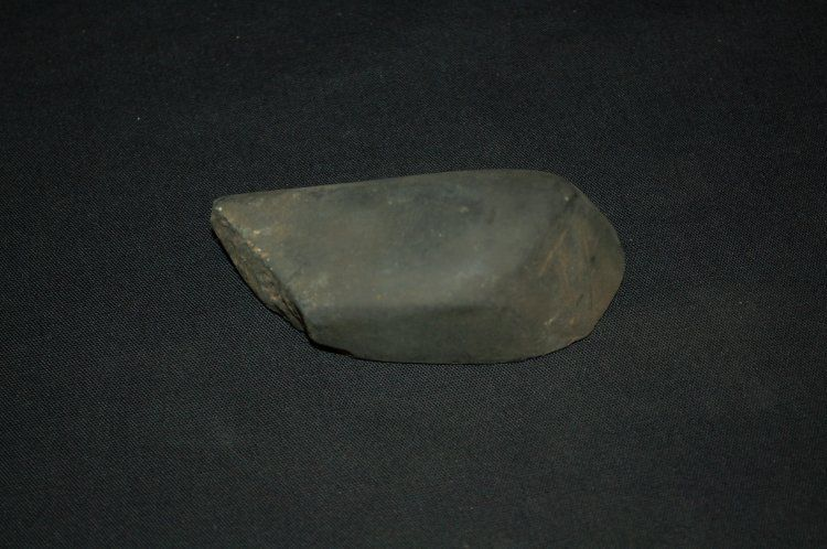 Stone tool. One side flattened, smooth and polished