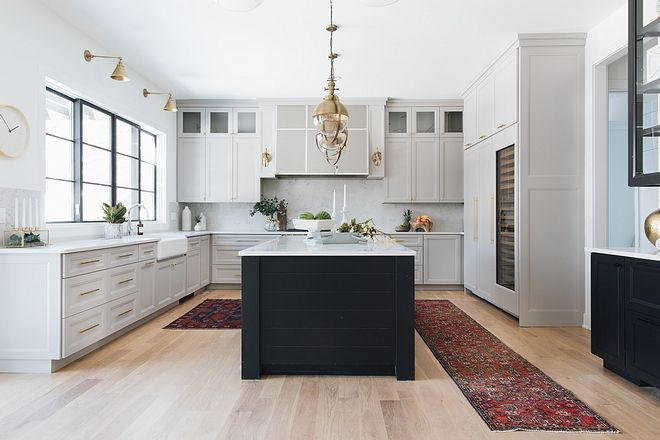 Modern Farmhouse Kitchen This Modern Farmhouse Kitchen Features Plenty Of Cabinetry And Large Black Kitchen Island Painted Kitchen Island New Kitchen Cabinets