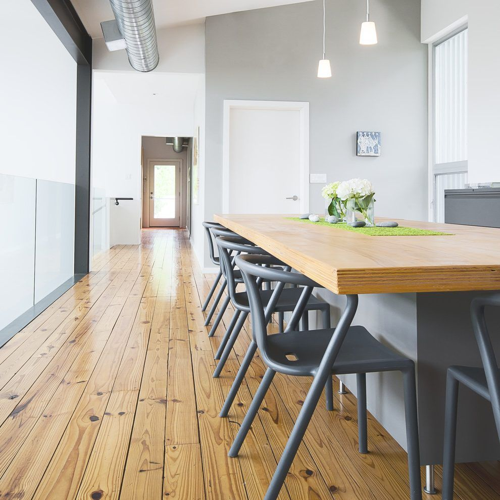 Accent Wall Next To Curved Ceiling Dining Table Centerpiece Among Duct Ductwork Amidst Exposed Hvac Near Gray Chairs Beside