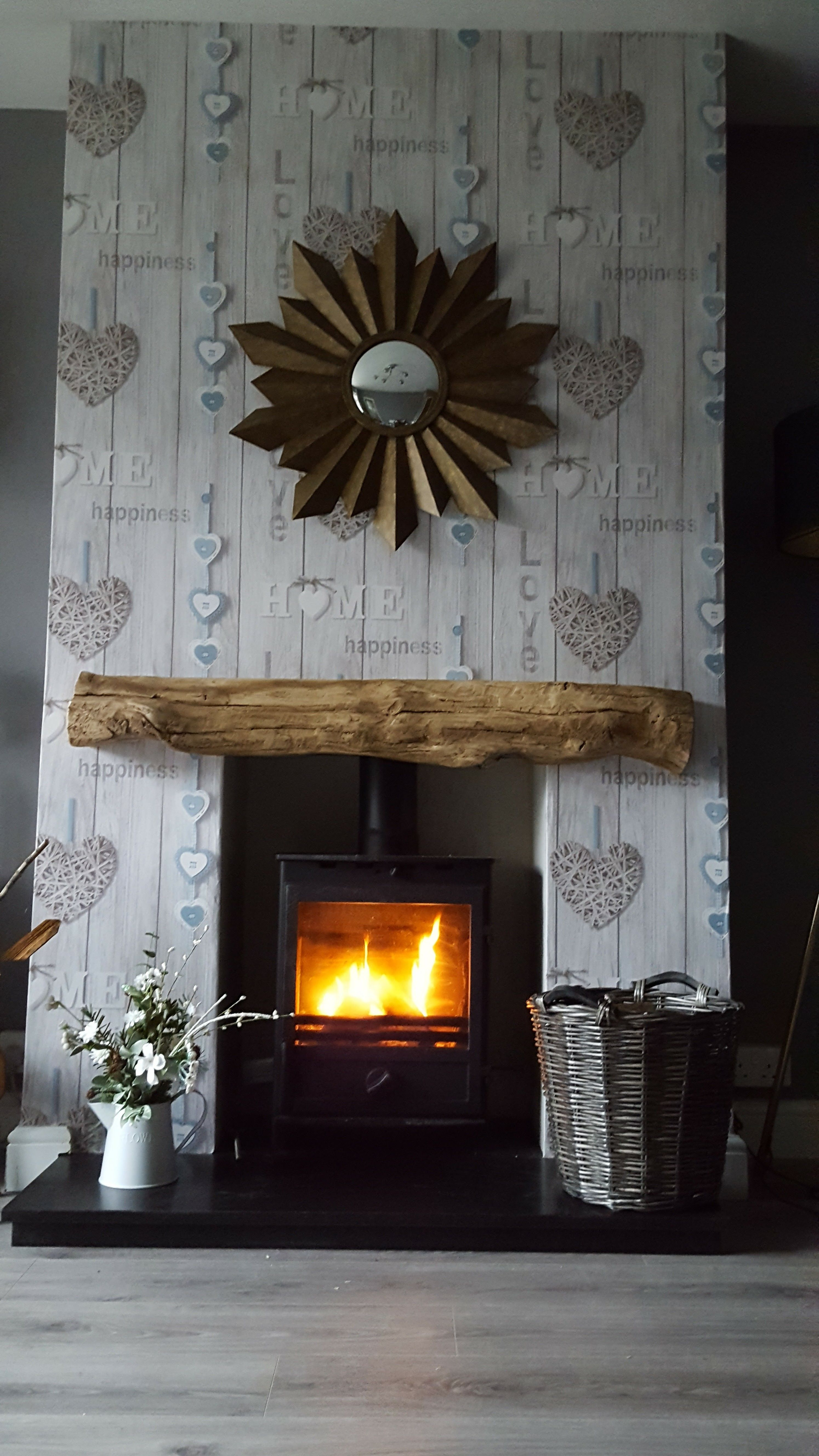 Installed this lovely wood burner and wallpapered chimney breast. | wallpapered fireplace with a ...