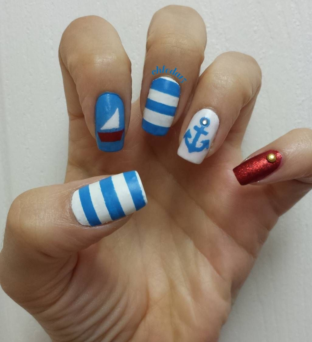 Concrete And Nail Polish Striped Nail Art: Thumb And Middle Nails With White And Blue Horizontal
