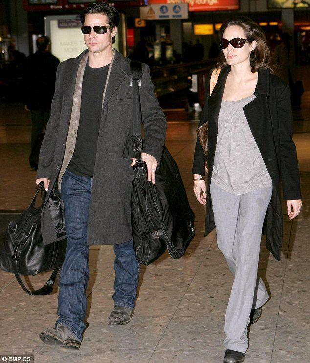 Happy news: The couple are pictured here in January 2006 after Angelina announced she was ...