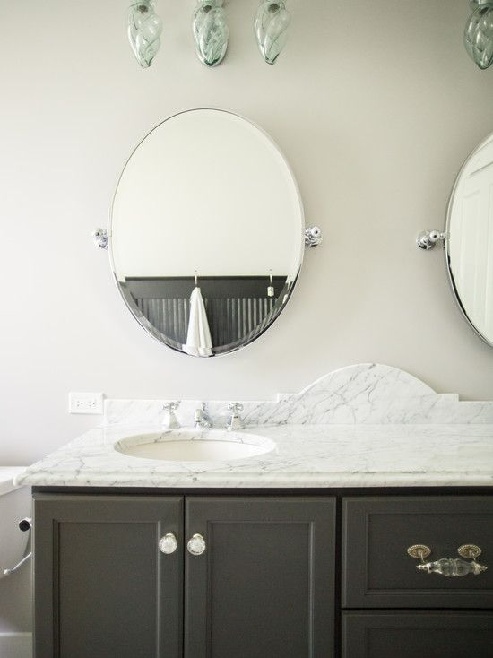 Black and white bathroom features black double vanity accented with