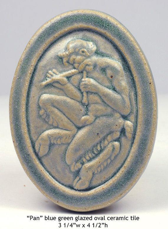 "Pan, blue-green glazed oval ceramic tile 3 1/4""w x 4 1/2""h"
