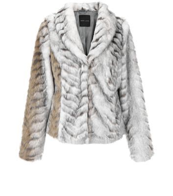 """Embrace the faux fur trend with this snow leopard design, great for a chic finish on evening styles.- Snow leopard faux fur design- Collared neck- Concealed fastening- Simple long sleeves- Casual fit that is true to size- Model is 5'8""""/176cm and wears UK 10/EU 38/US 6"""