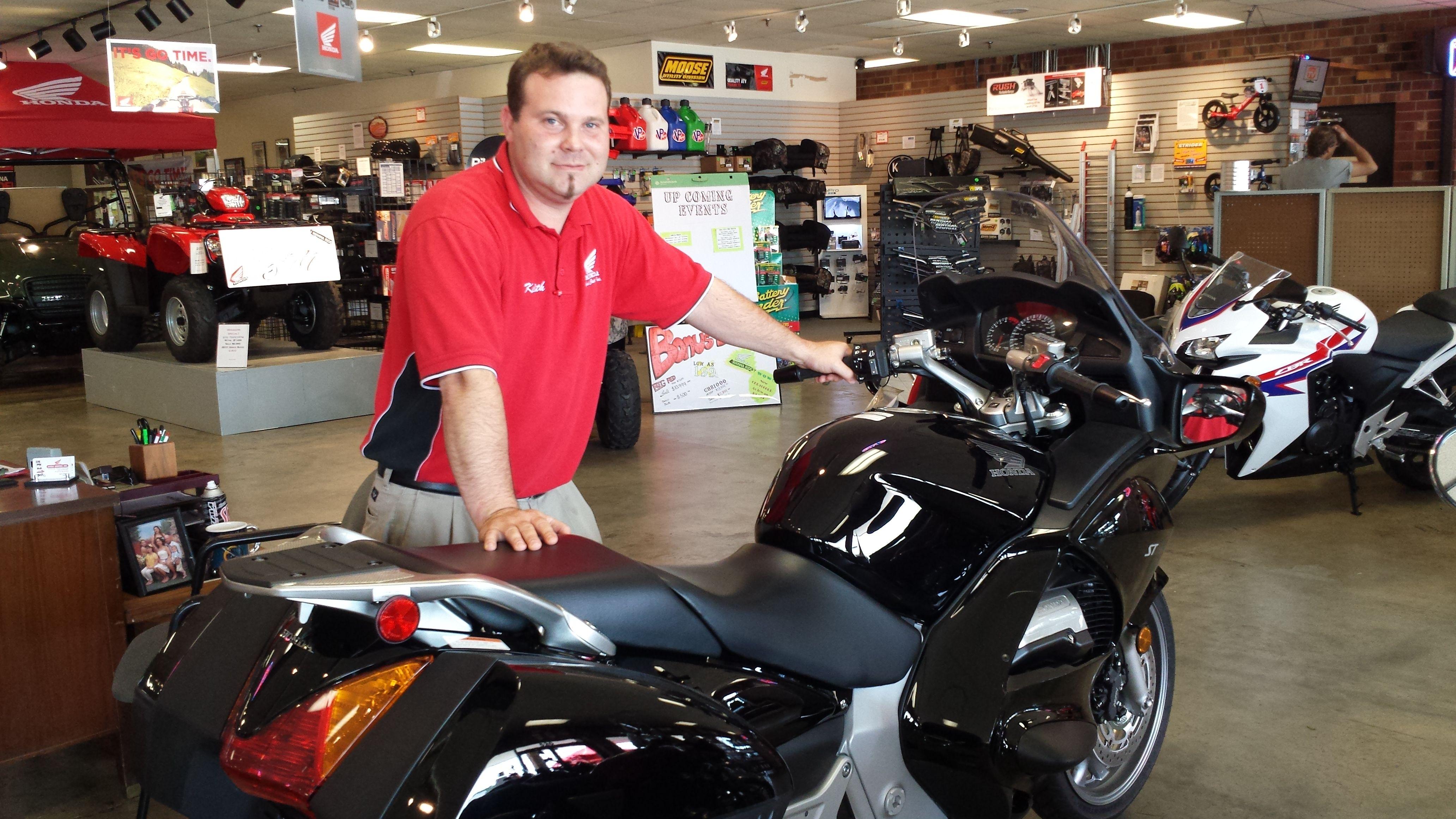 Salesman Keith Showing Off The Latest Honda Bikes Www Cyclecenterinc Com Honda Bikes Honda Bike