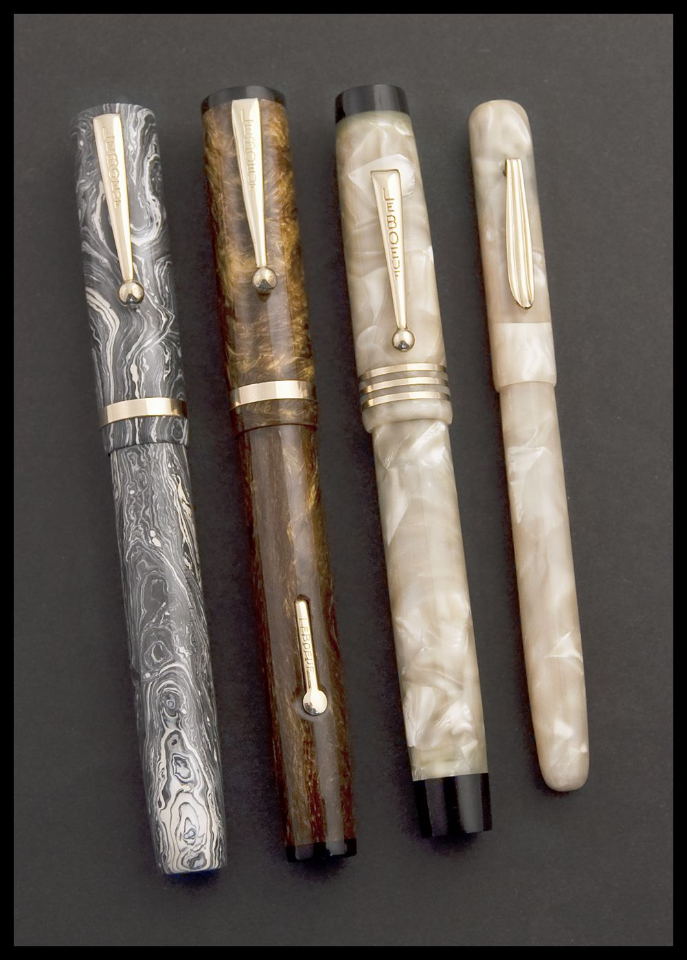 Three LeBoeuf fountain pens and a LeBoeuf Thermometer in cream pearl celluloid. Items made in Springfield between 1926 and 1932.