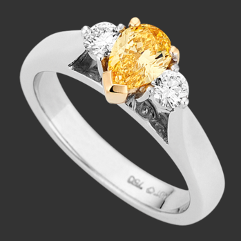 Australain Fancy Vivid Yellow Pear Shaped 3 stone Diamond Ring. Classic with a modern twist.   What are your thoughts?
