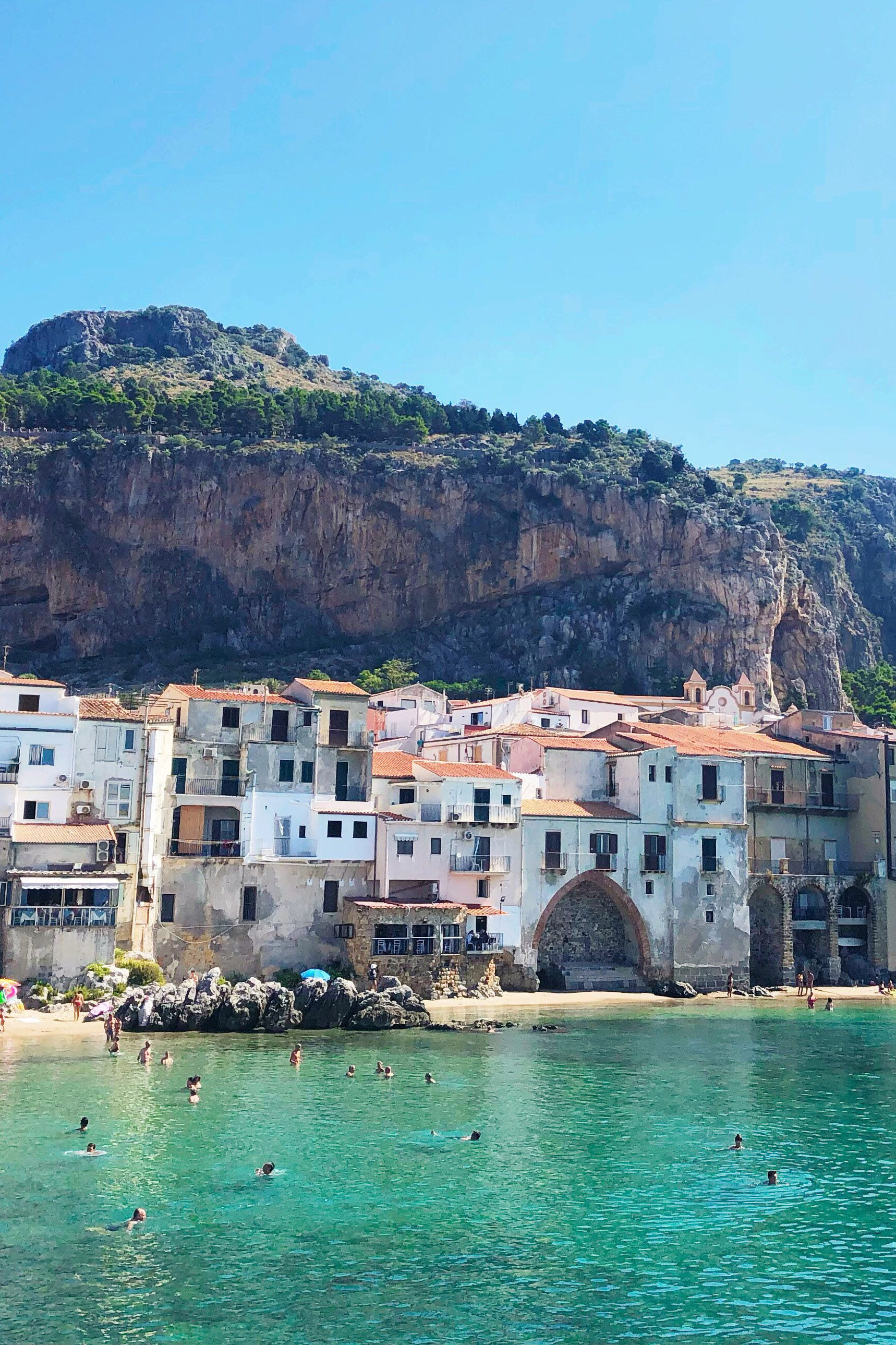 On a recent trip to Sicily, we discovered the beautiful seaside town of Céfalu. Pretty as a postcard, the colorful houses on the cliff next to the crystal blue water were breathtaking! Follow our Awol blog to get more inspiring travel photography and discover the travel stories behind our travel inspired designer collections. #cefalu #sicilytravel #beautifultravelphotography #bestbeaches #bestravelblog #bestbeaches #bestofsicily #travelinspired #creativeswhotravel #bestsicilytravels #seasidetown