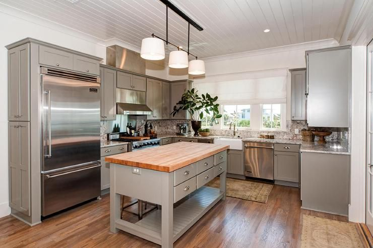 Beach Cottage Kitchen Features A Shiplap Ceiling Over Grey Beauteous Butcher Block Kitchen Island Design Ideas
