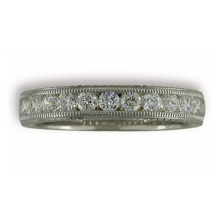 Beautiful wedding band with .50cttw of diamonds in 14 karat white gold with a milgrain finish.