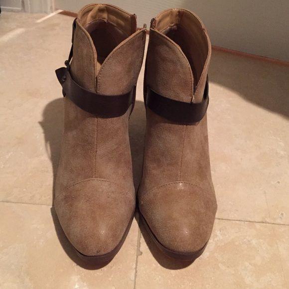 Brown booties Brown suede booties with dark brown belt design. Worn once! Easy to walk in a comfortable. 1 1-2 inch heel. Fits between 8 and 8 1/2 Shoes