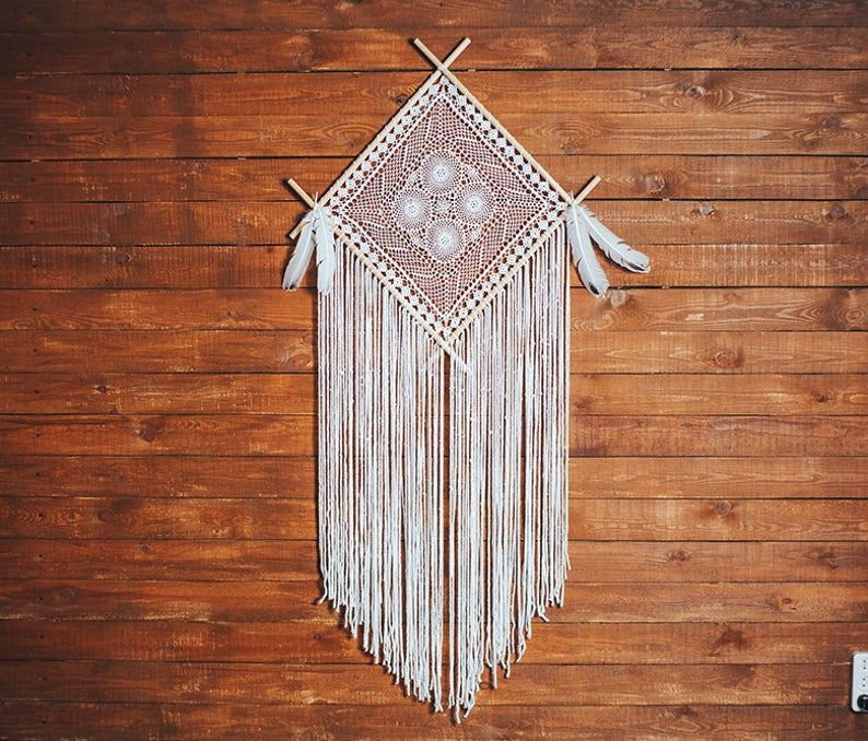 Would this unique boho dream catcher wall hanging melt your heart? Absolutely. This is a beautiful handcrafted wall art piece that will bring peace and serenity to your bedroom. Consider this white dream catcher, if are looking for a gift for a boho lover. Hygge wall art for a dream bohemian home. Pure beauty.  #dreamcatcher #dream catcher #bohodecor #bohohome #walldecorations