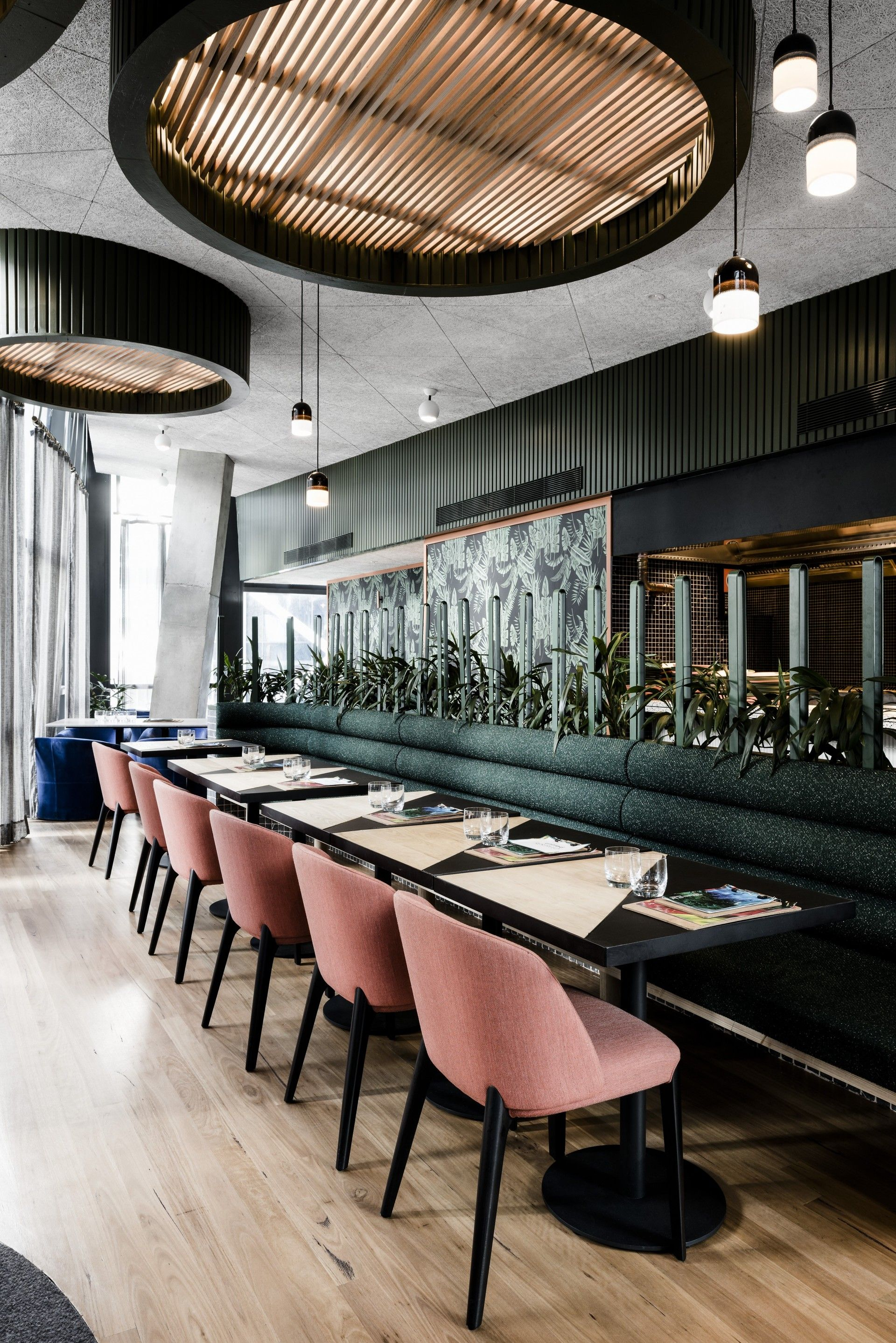 UNTIED By Techn Architecture Interior Design Restaurant Pink Velvet Chairs Dark Table Huge Flush Ceiling Lights And Wood Flooring