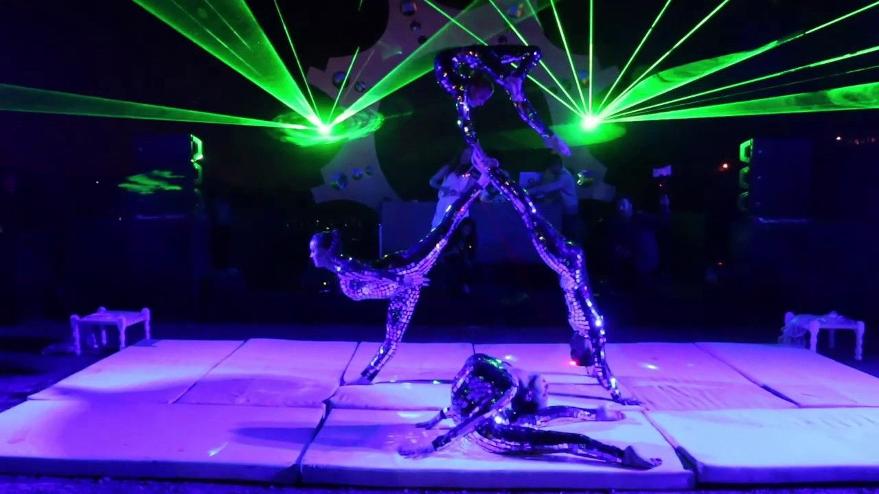Mirrorize is a laser show act with a minimum of 4 female