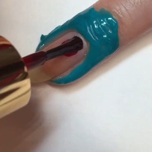 Here is a video showing you how I did the base of my last mani. I painted one coat of @esteelauder Enchanted Garnet and let it slightly dry. Then I swirled Enchanted Garnet and Oil Slick by @salonperfect and then used my stamper to pick up a random marbled pattern, and I placed it onto the nail. Add topcoat, and you're done! I used @latexfashions liquid latex around my nail. Song Hannah Cartwright - All You Leave Behind #esteelauderpolish #salonperfect #nailtutorial