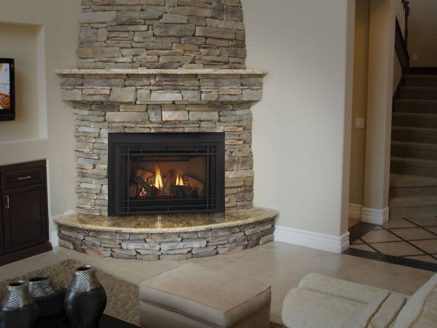 Love a stone wall but would have stand alone fire place Corner rock fireplace designs