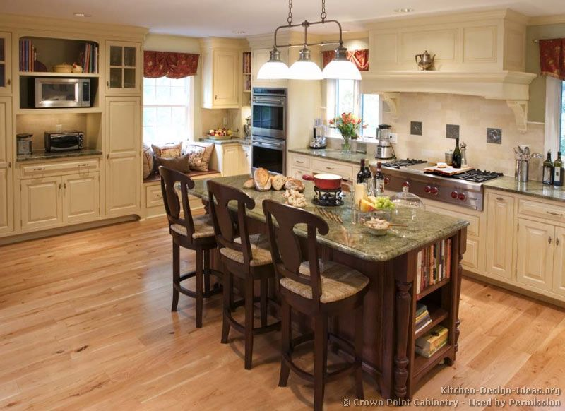 kitchen idea of the day antique white kitchen cabinet with a dark wood island - Kitchen Cabinets Islands Ideas