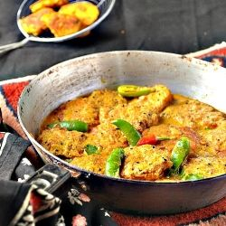 Fish row fritters cooked in a spicy Mustard gravy.